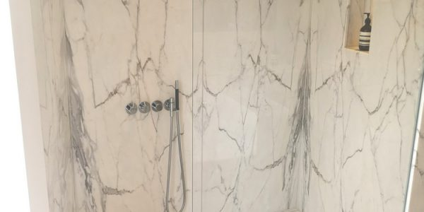 Calacatta-marble-bookmatch-shower-wall